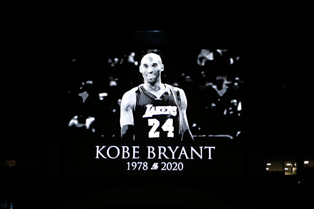 A tribute to Kobe Bryant was shown on the screen before the start of an NBA basketball game between the Orlando Magic and the Los Angeles Clippers in Orlando, Fla., Sunday, Jan. 26, 2020. (AP Photo/Reinhold Matay)
