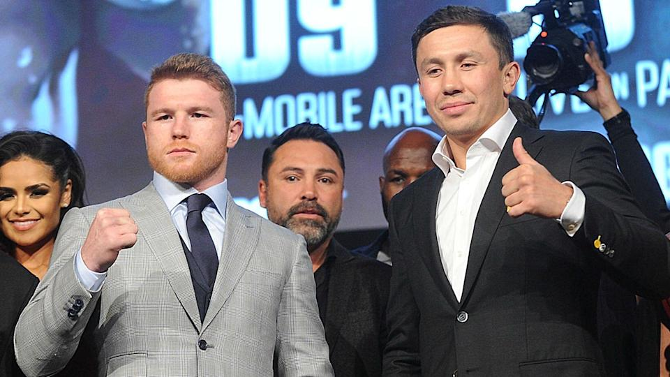 Canelo Alvarez (L) poses with Gennady Golovkin (R) to promote their Sept. 16 middleweight title bout in Las Vegas.