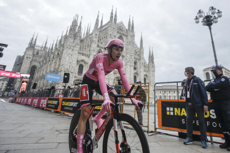 Australia's Jai Hindley rides past the gothic cathedral after compelting the final stage of the Giro d'Italia cycling race, a 15.7 kilometers (9.756 miles) individual time trial from Cernusco sul Naviglio to Milan, Italy, Sunday, Oct. 25, 2020. (AP Photo/Luca Bruno)