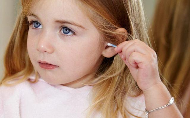 Turns out, you shouldn't be sticking cotton swabs in your ear. (Photo: Getty Images)