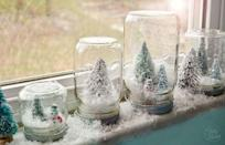 """<p>Worried about a mess? Then this waterless snow globe is for you! They're so cute that you should make a few and line them up on a windowsill, mantel or end table. </p><p><strong>Get the tutorial at <a href=""""https://tidymom.net/waterless-snow-globes-tutorial/"""" rel=""""nofollow noopener"""" target=""""_blank"""" data-ylk=""""slk:Tidy Mom"""" class=""""link rapid-noclick-resp"""">Tidy Mom</a>. </strong></p><p><a class=""""link rapid-noclick-resp"""" href=""""https://www.amazon.com/Krylon-Glitter-Blast-Aerosol-Ounces-Silver/dp/B00DZP1BUA/ref=sr_1_26?dchild=1&keywords=krylon+glitter+blast&qid=1603312415&sr=8-26&tag=syn-yahoo-20&ascsubtag=%5Bartid%7C10050.g.2832%5Bsrc%7Cyahoo-us"""" rel=""""nofollow noopener"""" target=""""_blank"""" data-ylk=""""slk:SHOP GLITTER SPRAY PAINT"""">SHOP GLITTER SPRAY PAINT</a></p>"""