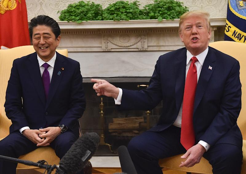"""US President Donald Trump gestures as Japan's Prime Minister Shinzo Abe smiles in the Oval Office at the White House in June; Trump has set his sights making Japan """"pay"""" for their trade surplus with the US, according to a columnist"""