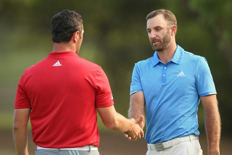 Dustin Johnson shakes Jon Rahm's hand after winning the WGC-Dell Technologies Match Play. (Getty Images)