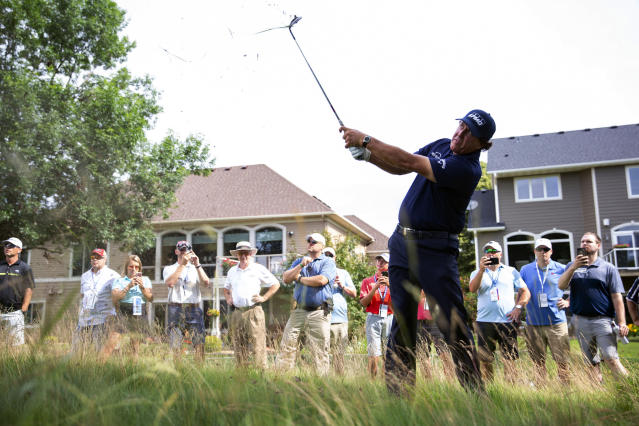 Phil Mickelson hits a ball out of the tall grass during the first round of the 3M Open golf tournament in Blaine, Minn., Thursday, July 4, 2019. (Alex Kormann/Star Tribune via AP)