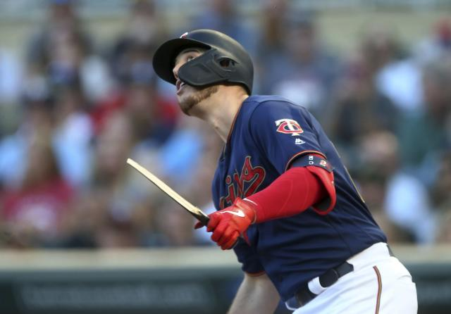 Minnesota Twins' C.J. Cron watches his broken-bat RBI single off Tampa Bay Rays pitcher Charlie Morton during the first inning of a baseball game Wednesday, June 26, 2019, in Minneapolis. (AP Photo/Jim Mone)