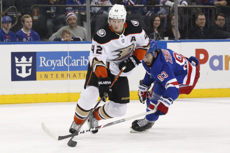 Anaheim Ducks defenseman Josh Manson (42) controls the puck in front of New York Rangers center Mika Zibanejad (93) during the second period of an NHL hockey game, Sunday, Dec. 22, 2019, in New York. (AP Photo/Kathy Willens)