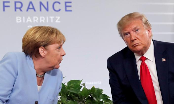 "<span class=""element-image__caption"">Trump meets Angela Merkel at the 2019 G7 summit in Biarritz. 'He has always been particularly rude to Merkel,"" an ex-White House official said.</span> <span class=""element-image__credit"">Photograph: Carlos Barría/Reuters</span>"