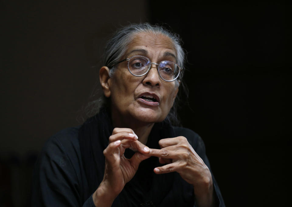 Pakistan's prominent rights activist Tahira Abdullah speaks about violence against women during an interview with The Associated Press in Islamabad, Pakistan, Tuesday, July 27, 2021. The beheading of a young woman in an upscale neighborhood of Pakistan's capital has shone a spotlight on the relentless violence against women in the country. Rights activists say such gender-based assaults are on the rise as Pakistan barrels toward greater religious extremism. (AP Photo/Anjum Naveed)