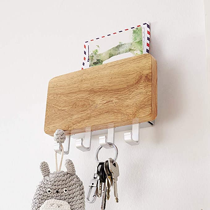 "<h3><a href=""https://amzn.to/2HZbfIO"" rel=""nofollow noopener"" target=""_blank"" data-ylk=""slk:Wooden Key & Mail Organizer"" class=""link rapid-noclick-resp"">Wooden Key & Mail Organizer</a> </h3><br>Give them a sleek and minimalist solution for keeping their entryway essentials organized and accounted for. <br><br><strong>KAIYING</strong> Wood Wall Mounted Key Organizer, $, available at <a href=""https://amzn.to/2HZbfIO"" rel=""nofollow noopener"" target=""_blank"" data-ylk=""slk:Amazon"" class=""link rapid-noclick-resp"">Amazon</a>"