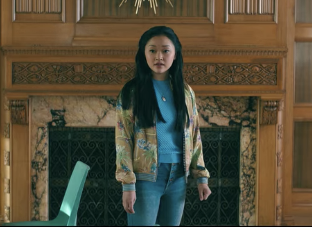 Lara Jean doesn't wear jeans much throughout any of the <em>TATB</em> films, but this outfit is one of our faves. A printed bomber jacket over a blue tee and jeans is the perfect 'fit for a casual weekend. Keeping things simple but stylish!