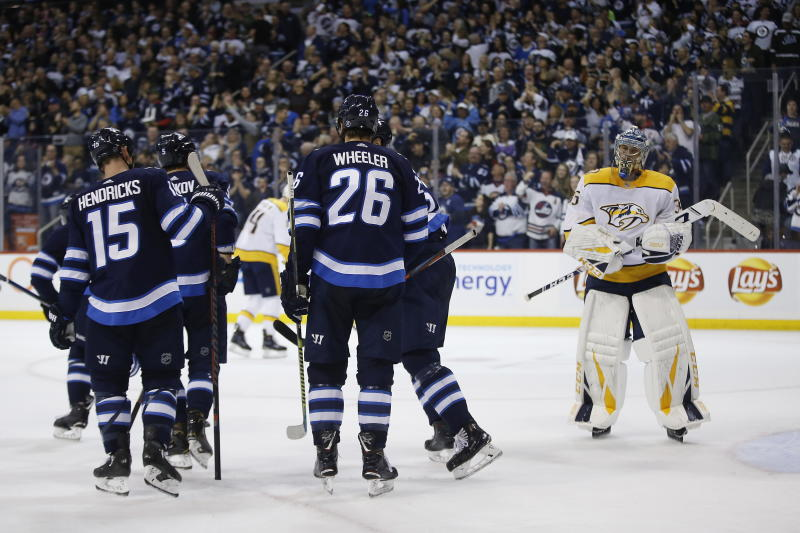 Winnipeg Jets celebrate Andrew Copp's (9) goal as Nashville Predators goaltender Pekka Rinne (35) look on during the second period of an NHL hockey game, Saturday, March 23, 2019 in Winnipeg, Manitoba. (John Woods/Canadian Press via AP)