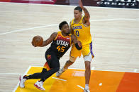 Utah Jazz guard Donovan Mitchell (45) drives against Los Angeles Lakers forward Kyle Kuzma (0) during the second half of an NBA basketball game Wednesday, Feb. 24, 2021, in Salt Lake City. (AP Photo/Rick Bowmer)