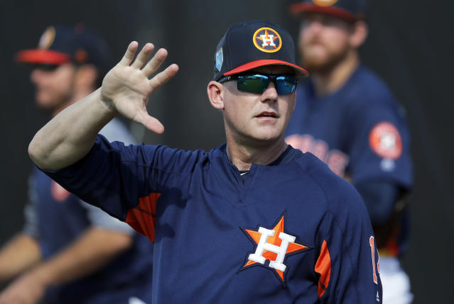 Houston Astros manager A.J. Hinch waves during spring training baseball practice Thursday, Feb. 15, 2018, in West Palm Beach, Fla. (AP Photo/Jeff Roberson)