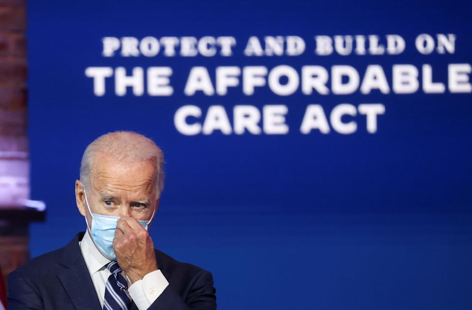 U.S. President-elect Joe Biden adjusts his face mask after during a brief news conference, where he discussed health care and the Affordable Care Act (Obamacare, at the theater serving as his transition headquarters in Wilmington, Delaware, U.S., November 10, 2020. REUTERS/Jonathan Ernst??