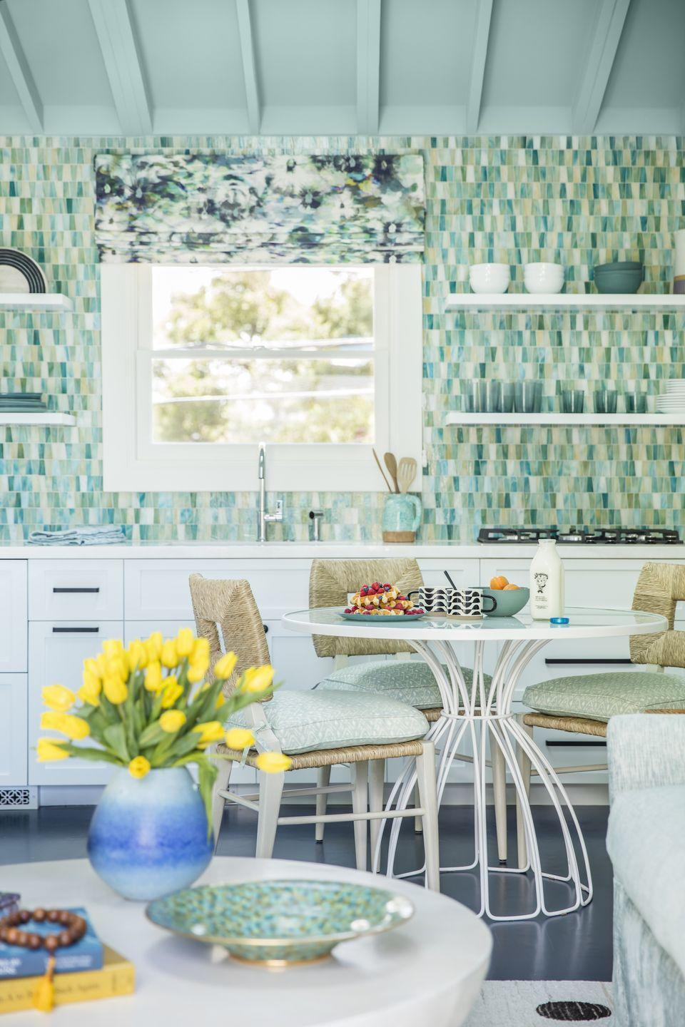 """<p>Speaking of aqua hues, designer <a href=""""https://www.markatosdesign.com/"""" rel=""""nofollow noopener"""" target=""""_blank"""" data-ylk=""""slk:Christine Markatos Lowe"""" class=""""link rapid-noclick-resp"""">Christine Markatos Lowe</a> is likewise predicting a resurgence of the midcentury-favorite shade for both cabinetry and tile applications. """"Bolder colors like turquoise and jade really pop against whites but still feel clean and fresh for a kitchen,"""" she says. </p>"""