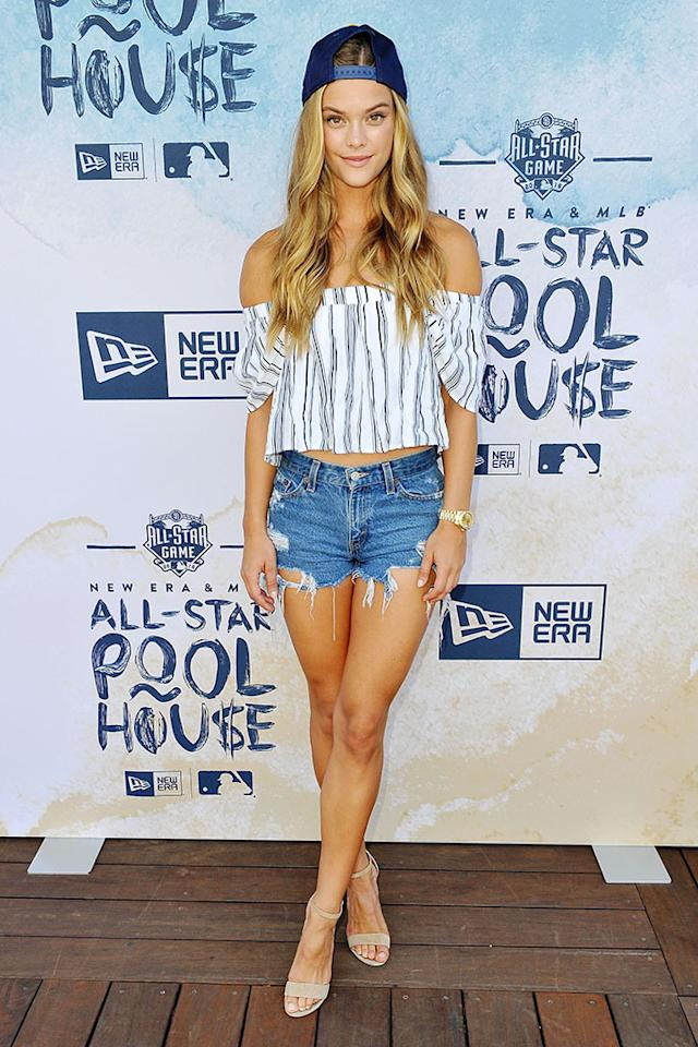 <p>Taking a break from (literally) the playing field at the MLB All-Stars and celebs game, Nina Agdal hit up the New Era Pool House at MLB All-Star Week in a pair of cut-up-to-there shorts and a sweet, off-the-shoulder top. In keeping with the week's theme, the <i>Sports Illustrated</i> model finished her look with a backward baseball cap. <i>(Photo: Jerod Harris/Getty Images for New Era)</i></p>