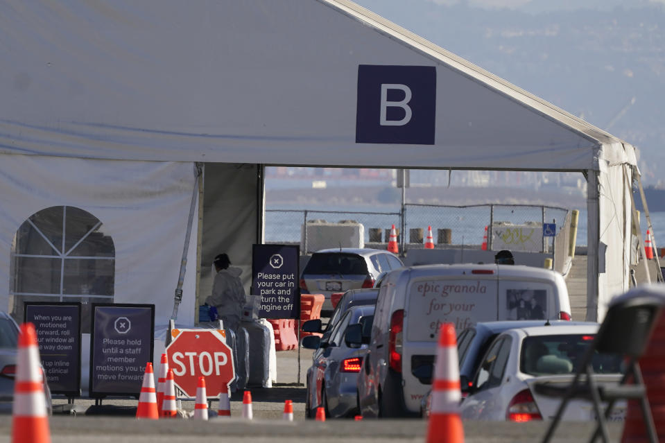 Vehicles line up at a COVID-19 testing site during the coronavirus outbreak in San Francisco, Monday, Nov. 16, 2020. (AP Photo/Jeff Chiu)