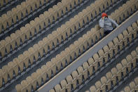 A lone spectator watches Italy's Matteo Berrettini and Canada's Vasek Pospisil in the first round match of the French Open tennis tournament at Suzanne Lenglen court of the Roland Garros stadium in Paris, France, Tuesday, Sept. 29, 2020. (AP Photo/Christophe Ena)