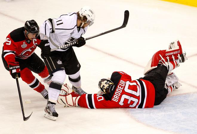 NEWARK, NJ - JUNE 02: Martin Brodeur #30 of the New Jersey Devils makes a save as Anze Kopitar #11 of the Los Angeles Kings and Zach Parise #9 look on during Game Two of the 2012 NHL Stanley Cup Final at the Prudential Center on June 2, 2012 in Newark, New Jersey.  (Photo by Paul Bereswill/Getty Images)