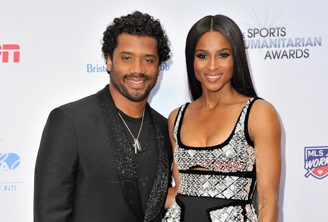 Seahawks quarterback Russell Wilson and his wife, Ciara, have joined the Seattle Sounders' ownership group. (Allen Berezovsky/Getty Images)