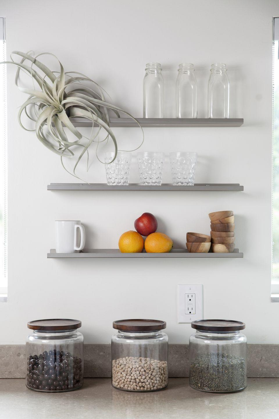 """<p>If your <a href=""""https://www.goodhousekeeping.com/home/organizing/tips/a31900/little-counterspace-design-tricks/"""" rel=""""nofollow noopener"""" target=""""_blank"""" data-ylk=""""slk:kitchen lacks storage"""" class=""""link rapid-noclick-resp"""">kitchen lacks storage</a>, your counter will feel the brunt of the problem. So choose pretty containers (and not a lineup of grocery store boxes) when you have to devote visible space to food. </p>"""