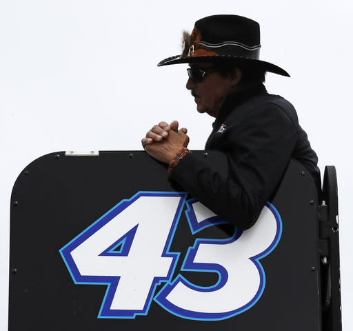 Racing legend Richard Petty watches practice prior to car qualifying for the NASCAR Cup Series auto race at New Hampshire Motor Speedway in Loudon, N.H., Friday, Sept. 22, 2017. (AP Photo/Charles Krupa)