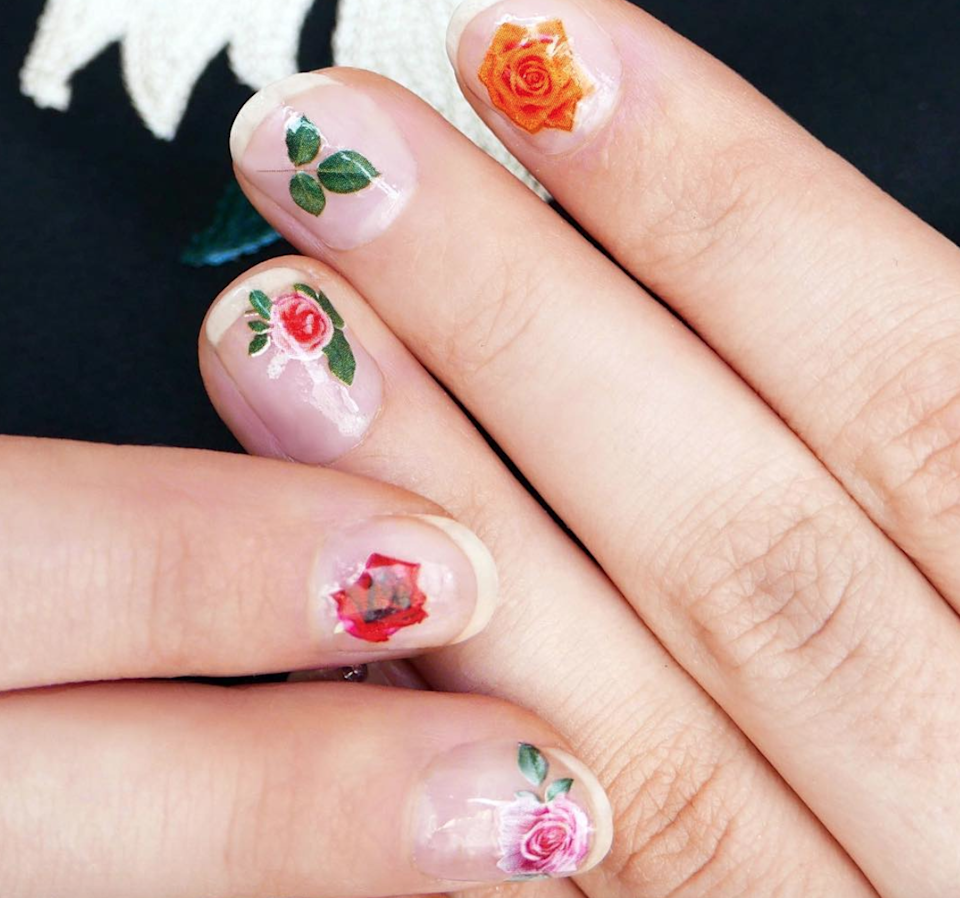 """Ornate blooms on bare nails look like true works of art. Try <a href=""""https://www.etsy.com/listing/740169172/colorful-flowers-nail-tattoos-flower?gpla=1&gao=1&utm_campaign=shopping_us_Tattoorary_sfc_osa&utm_medium=cpc&utm_source=google&utm_custom1=0&utm_content=9118558&gclid=EAIaIQobChMImLaKrbaV6AIVlI7ICh0d2QPHEAQYAiABEgL3IvD_BwE"""" rel=""""nofollow noopener"""" target=""""_blank"""" data-ylk=""""slk:these stickers"""" class=""""link rapid-noclick-resp"""">these stickers</a> for a similar vibe."""