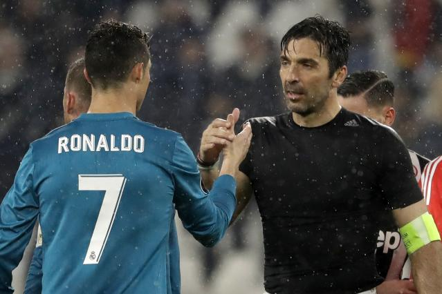 FILE - In this Tuesday, April 3, 2018 filer, Juventus goalkeeper Gianluigi Buffon, right, shakes hands with Real Madrid's Cristiano Ronaldo after the Champions League, round of 8, first-leg soccer match between Juventus and Real Madrid at the Allianz stadium in Turin, Italy. Juventus captain Gianluigi Buffon has announced he is leaving the Italian club but the goalkeeper could continue playing elsewhere. Buffon, who is widely regarded as one of the best goalkeepers of all time, was expected to announce his retirement at a press conference at Allianz Stadium on Thursday, May 17, 2018. (AP Photo/Luca Bruno, File)