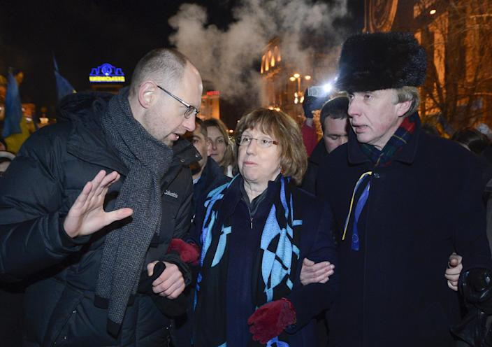Ukrainian opposition leader Arseniy Yatsenyuk, left, and EU foreign policy chief Catherine Ashton, center, and former Ukrainian Foreign Minister Vladimir Ogryzko, right, arrive to meet Pro-European Union activists gathered on the Independence Square in Kiev, Ukraine, Tuesday, Dec. 10, 2013. Some demonstrators arrested in the massive protests sweeping Ukraine's capital will be released, embattled President Viktor Yanukovych promised Tuesday, trying to defuse a political standoff that is threatening his leadership. (AP Photo/Andrew Kravchenko)