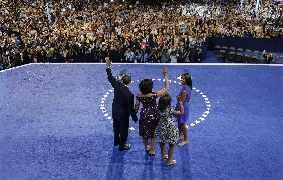 President Barack Obama waves with his wife Michelle and his daughters Malia and Sasha after his speech to the Democratic National Convention in Charlotte, N.C., on Thursday, Sept. 6, 2012. (AP Photo/Charlie Neibergall)