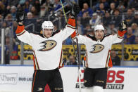 Anaheim Ducks' Max Comtois, left, celebrates after scoring as teammate Hampus Lindholm also celebrates during the first period of an NHL hockey game against the St. Louis Blues Monday, Jan. 13, 2020, in St. Louis. (AP Photo/Jeff Roberson)