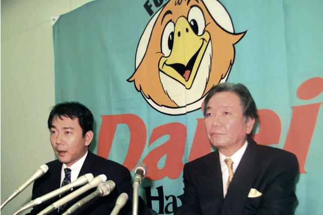 In this December 1998, photo, then Fukuoka Daiei Hawks President Hiroshi Murakami, right, and acting owner Tadashi Nakauchi speak to journalists during a press conference on a suspicion of sign stealing at Fukuoka Dome in Fukuoka, southern Japan. If you thought the use of technology to steal catchers' signs was only a problem for Major League Baseball and the Houston Astros, or something new. Japan went through a similar scandal just over 20 years ago. In a widely reported scandal in 1998, a camera in the Fukuoka Dome was discovered to be focused on the catcher. Officials of the Hawks - now the SoftBank Hawks - reportedly monitored the signs and relayed them by walkie-talkie to fans in the stands, who then used signals to batters to indicated the next pitch. (Kyodo News via AP)