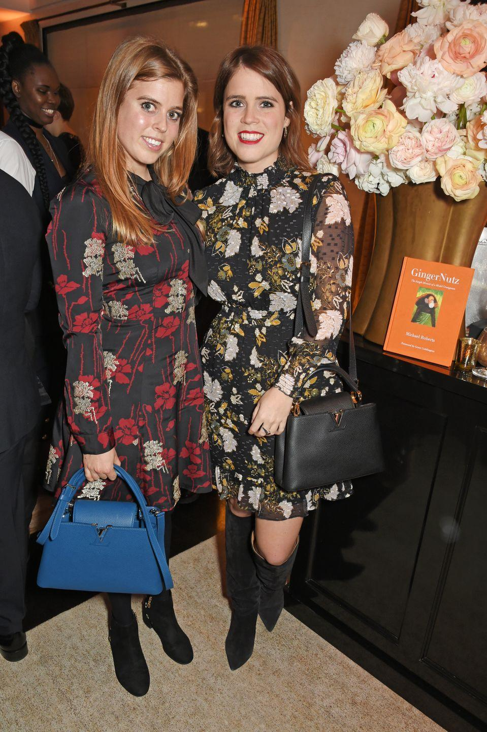 <p>Princesses Beatrice and Eugenie both wore dark florals to a book party hosted by Louis Vuitton in November 2017. </p>