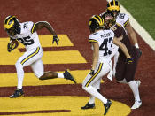 Michigan running back Hassan Haskins (25) runs for a touchdown in the first half of an NCAA college football game against Minnesota Saturday, Oct. 24, 2020, in Minneapolis, Minn. (Aaron Lavinsky/Star Tribune via AP)