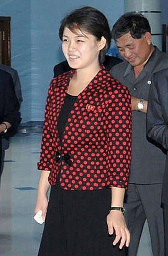 This file photo, released by North Korea's official Korean Central News Agency on July 26, shows N.Korean leader Kim Jong-Un's wife Ri Sol-Ju during a visit to a dolphinarium of the Rungna People's Pleasure Ground in Pyongyang