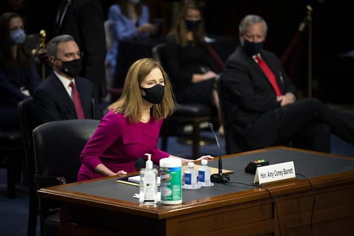 Supreme Court nominee Amy Coney Barrett arrives for her Senate Judiciary Committee confirmation hearing on Capitol Hill in Washington, Monday, Oct. 12, 2020. (Caroline Brehman/Pool via AP)