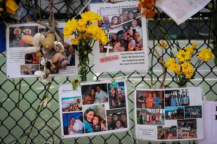 Photos of the Guara family are posted on the fence of the makeshift memorial of the victims of Champlain Towers South partial collapse. The family of four -- Marcus Guara, Anaely Rodriguez and their daughters, Lucia, 10, and Emma, 4 -- died in the condo collapse in Surfside.