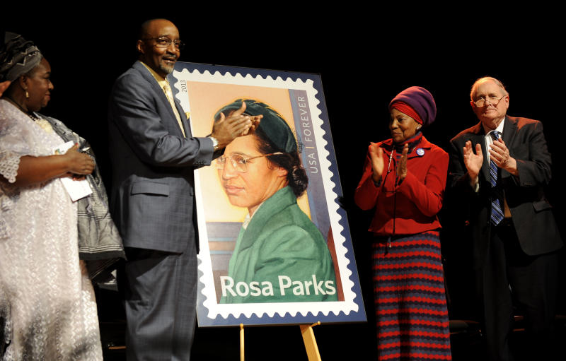 Councilwoman Joann Watson, from left, Lloyd Wesley, Jr., Detroit postmaster,  Elaine Eason Steele, co-founder of the Rosa and Raymond Parks Institute for Self Development, and Sen. Carl Levin applaud at the unveiling of the Rosa Parksí 100th birthday commemorative postage stamp at the Museum of African American History in Detroit on Monday, Feb. 4, 2013. The Rosa Parks Forever Stamp went on sale Monday and was part of a series of events scheduled throughout the day to honor her. AP Photo/The  Detroit News, David Coates)  DETROIT FREE PRESS OUT, HUFFINGTON POST OUT
