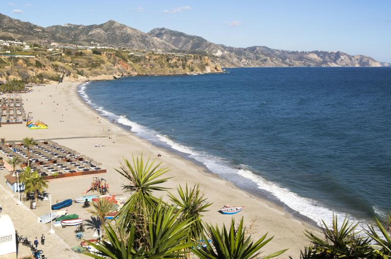 Playa Burriana sandy beach at popular holiday resort town of Nerja, Malaga province, Spain. (Photo by: Geography Photos/Universal Images Group via Getty Images)