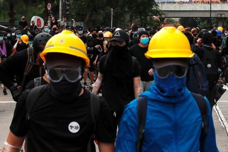 FILE PHOTO: Anti-extradition bill protesters set up barriers as they face riot police after a march at Sha Tin District of East New Territories, Hong Kong