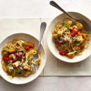 <p>This healthy chicken pasta recipe is jazzed up with traditional bruschetta toppers, including cherry tomatoes, garlic and basil. Multicolored cherry tomatoes look pretty, but you can use all one color of tomato too. Either way, you've got an easy weeknight dinner that's ready in 25 minutes. We've called for spaghettini (thin spaghetti) in this recipe, but feel free to use your favorite shape of pasta.</p>
