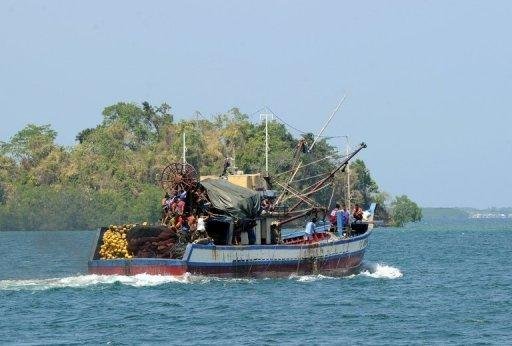 A Filipino-owned fishing boat sets off for a fishing expedition near the Scarborough Shoal on May 10