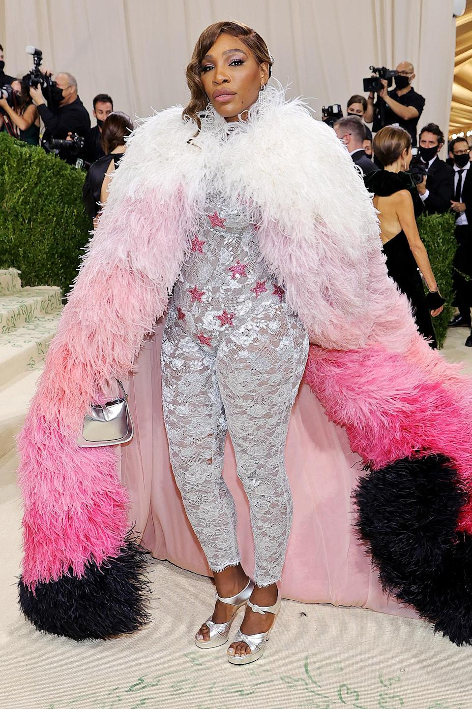 <p>Joined by her husband Alexis Ohanian for the event, the tennis champion wore a silver lace catsuit with pink stars by Gucci, paired with an ombre pink feather cape.</p>
