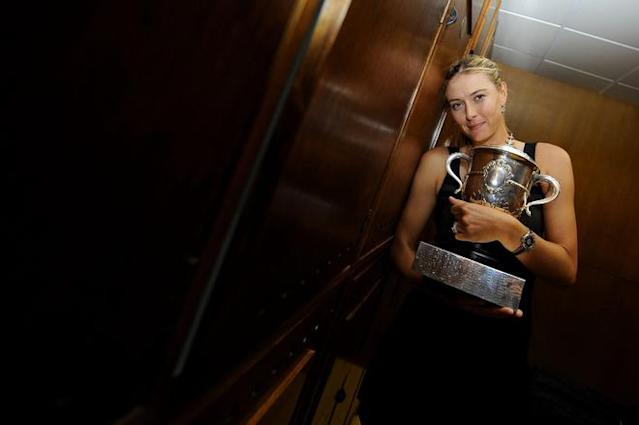 PARIS, FRANCE - JUNE 09: Maria Sharapova of Russia celebrates with the Coupe Suzanne Lenglen in her changing room after her women's singles final against Sara Errani of Italy during day 14 of the French Open at Roland Garros on June 9, 2012 in Paris, France. (Photo by Sindy Thomas - Pool/Getty Images)