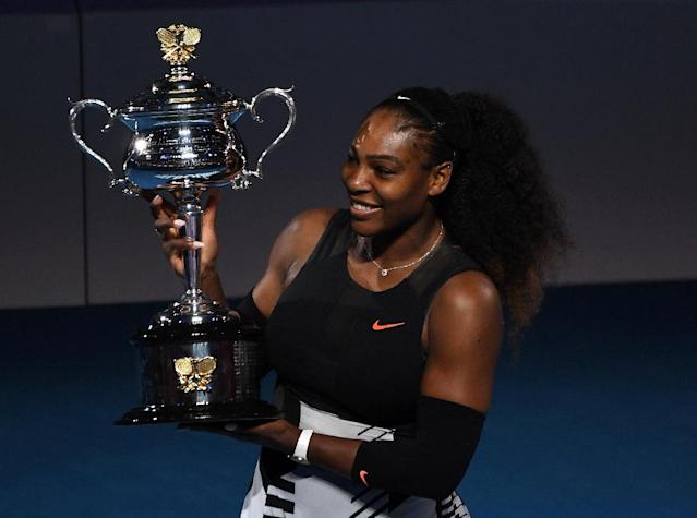Serena Williams holds the trophy following her 2017 Australian Open victory over Venus Williams (AFP Photo/Greg Wood)
