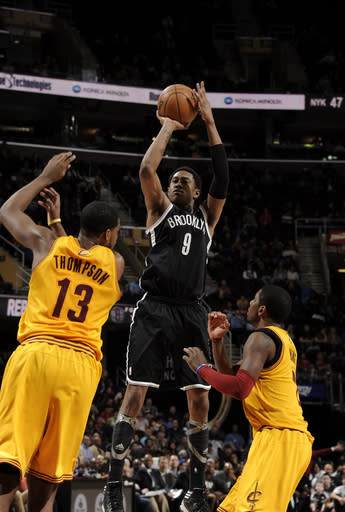 CLEVELAND, OH - APRIL 3: MarShon Brooks #9 of the Brooklyn Nets shoots against Kyrie Irving #2 and Tristan Thompson #13 of the Cleveland Cavaliers at The Quicken Loans Arena on April 3, 2013 in Cleveland, Ohio. (Photo by David Liam Kyle/NBAE via Getty Images)