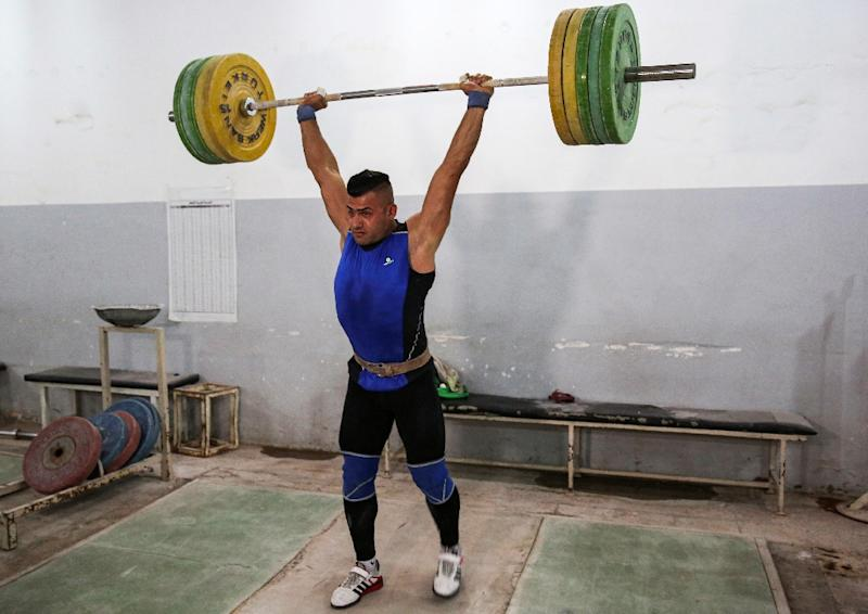 Iraqi weightlifter Safaa Rashed Aljumaili lifts weights as he trains at a gym in the capital Baghdad