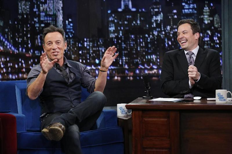 """This image released by NBC shows Bruce Springsteen, left, with host Jimmy Fallon during an appearance on """"Late Night with Jimmy Fallon,"""" on Tuesday, Jan. 14, 2014 in New York. (AP Photo/NBC, Lloyd Bishop)"""