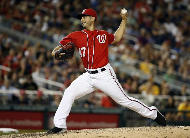 Washington Nationals starting pitcher Gio Gonzalez throws during the fourth inning of a baseball game against the Pittsburgh Pirates at Nationals Park, Saturday, Aug. 16, 2014, in Washington. (AP Photo/Alex Brandon)
