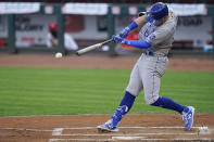 Kansas City Royals first baseman Ryan O'Hearn (66) hits a double during the second inning of a baseball game against the Cincinnati Reds at Great American Ballpark in Cincinnati, Tuesday, August 11, 2020. (AP Photo/Bryan Woolston)